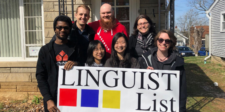 "Students hold up a sign for ""Linguist List"""